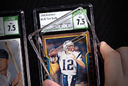 A sports card is placed in the industry-leading CSG holder during the encapsulation step of the CSG grading process.